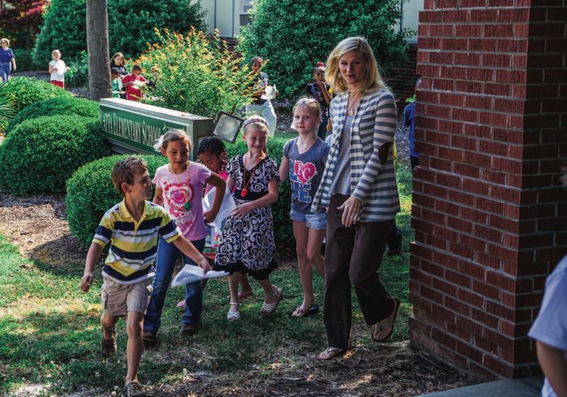 Amanda Morrell with students, walking through school gardens