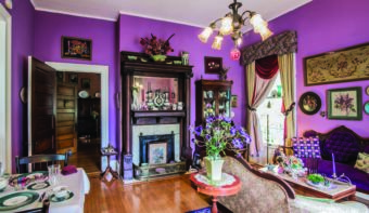 A purple living room at the inn.