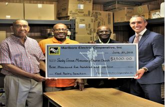 Marlboro Electric Cooperative's President and CEO, William Fleming, Jr. presented a $3,500 check to Pastor Gilbert Wilson