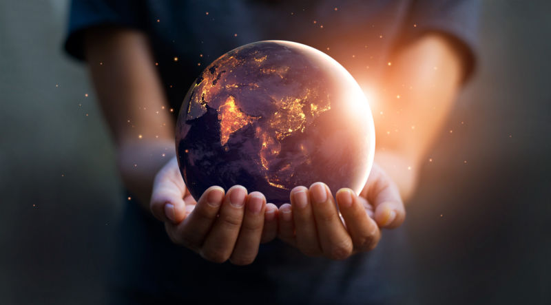 Hands holding an earth globe