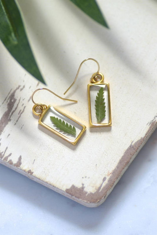 Earrings with a botanical fern inside