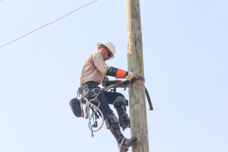 Justin working on a powerline