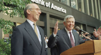 Hugh standing next to David Coulter, speaking in front of Bank of America.