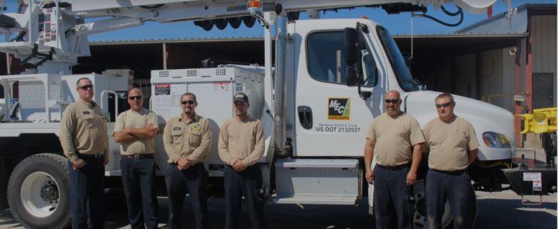 MEC workers standing in front of truck