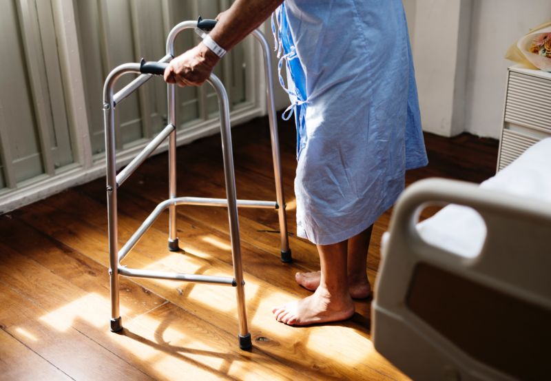 Elderly adult using walker